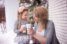 a young mom spending time with her little daughter