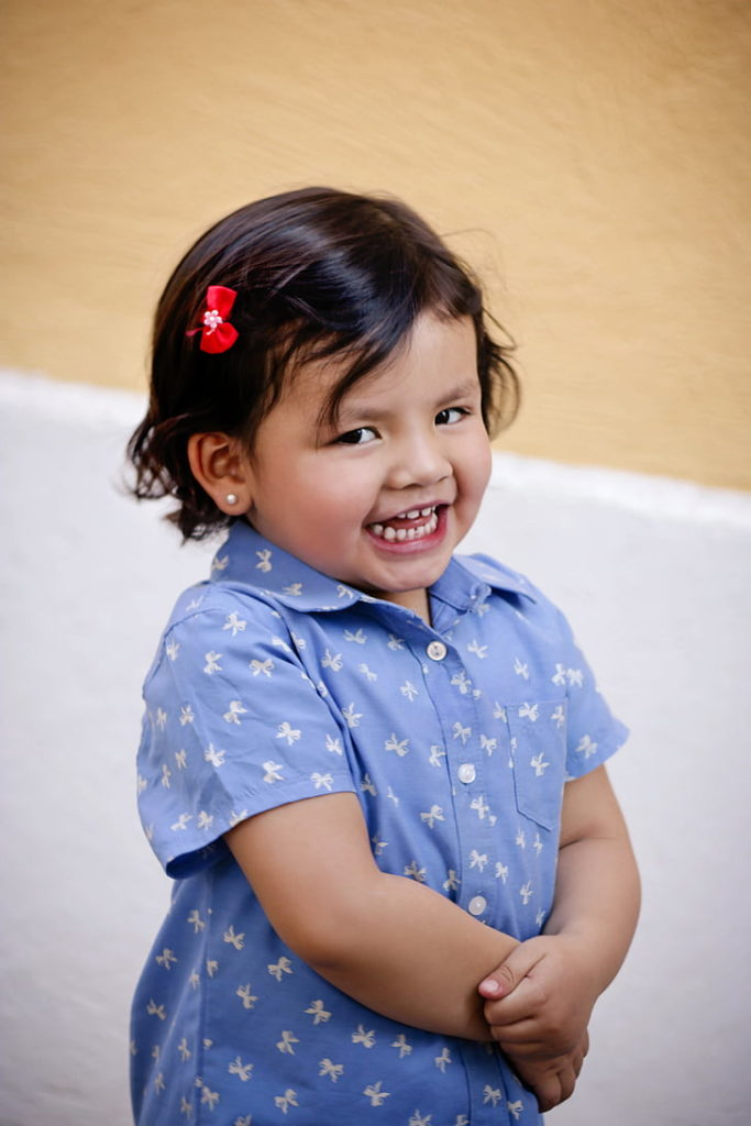 smiling baby girl in blue dress