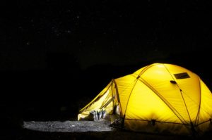 A yellow tent in night for a road trip