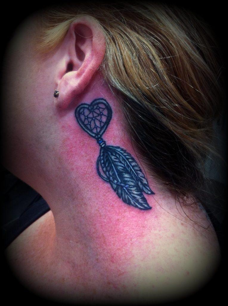 dreamcatcher tattoo with heart instead of woven net