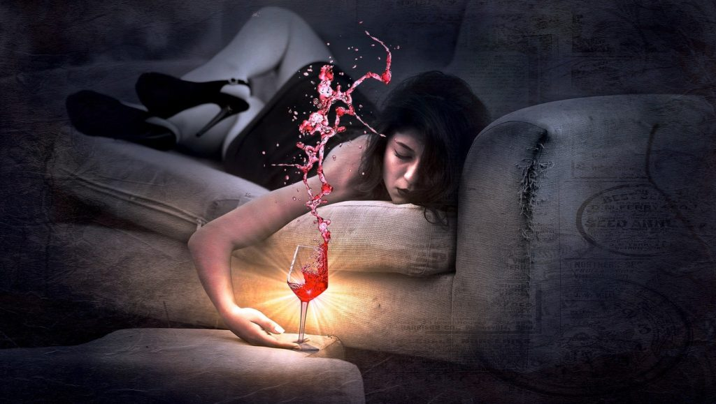 Girl Sleeping on Couch with Alcohol glass on table
