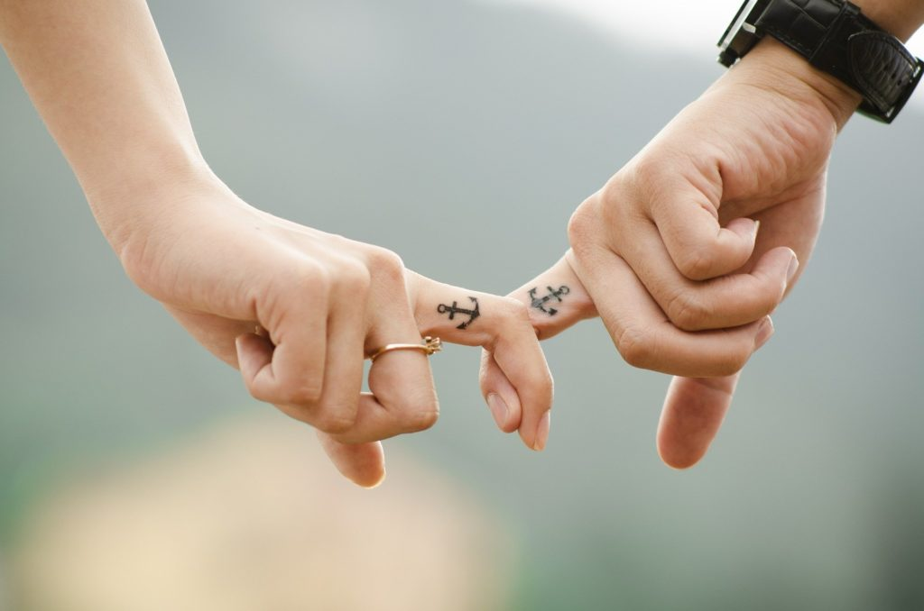 Micro anchor tattoos on fingers