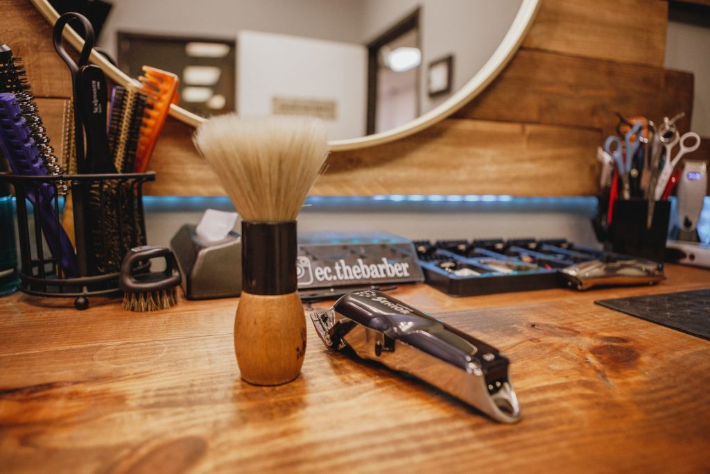 Beard grooming kit products on a wooden table